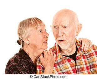 Senior woman sharing information with skeptical man