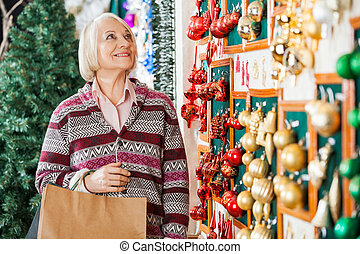 Senior Woman Shopping Christmas Ornaments