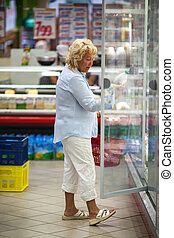 Senior woman shopping for dairy products