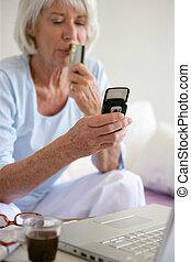 Senior woman shopping on-line