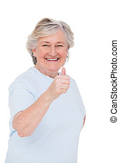Senior woman showing thumbs up