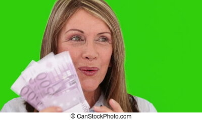 Senior woman showing us her cash