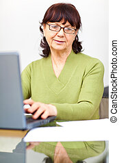 Senior woman sitting at the table