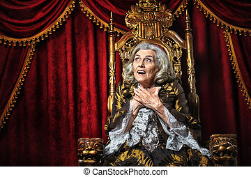 senior woman sitting in vintage chair