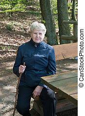 senior woman sitting on a bench
