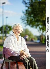 Senior woman sitting on bench