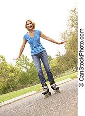 Senior Woman Skating In Park