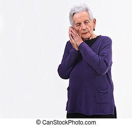 Senior woman sleeping on white background
