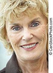 Senior Woman Smiling At The Camera