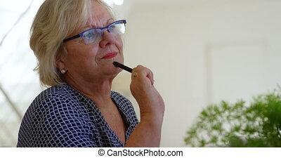 Senior woman smiling in living room 4k - Thoughtful senior ...
