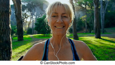 Senior woman smiling in the park 4k