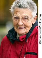 Senior woman - Smiling senior woman in red jacket with short...