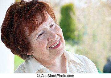 Senior woman smiling - Happy senior woman smiling outdoor