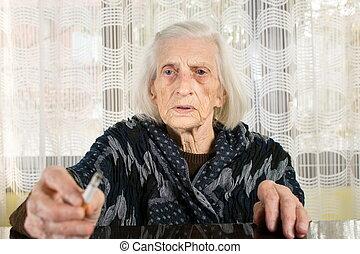 Senior woman smoking a cigarette