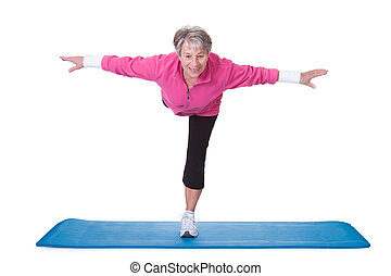 Senior Woman Standing On One Leg And Exercising