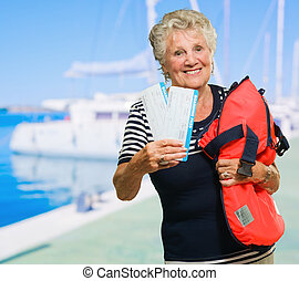 Woman Standing With Tickets And Bag