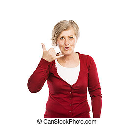 Senior woman - Happy senior woman pretending phonecall,...