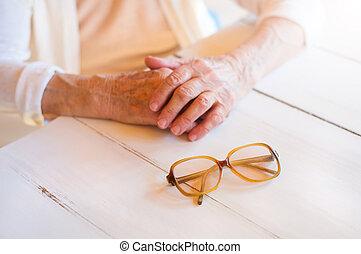 Senior woman - Hands of unrecognizable senior woman holding...