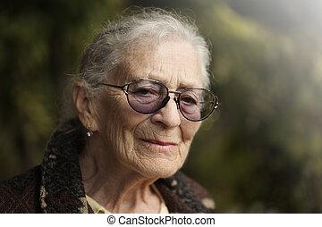 Senior woman - Portrait of senior woman outdoors. Closeup.
