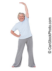 Senior woman stretching her arms