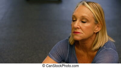 Senior woman stretching in fitness studio 4k - Close-up of...