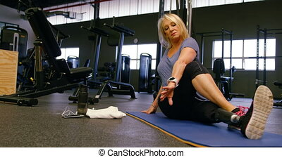 Senior woman stretching in fitness studio 4k - Determined...