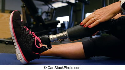 Senior woman stretching in fitness studio 4k - Low section...