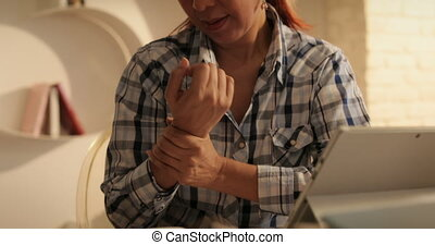 Senior Woman Suffering For Carpal Tunnel Syndrome Using...
