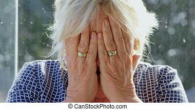 Senior woman suffering from headache 4k