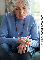Senior Woman Suffering With Parkinsons Diesease