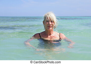 Senior woman swimming in the sea