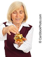 senior woman, takarékbetét pénz, alatt, piggybank