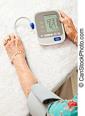 Senior Woman Taking Blood Pressure