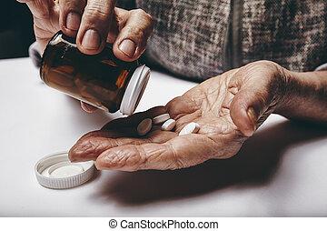 Senior woman taking medicine