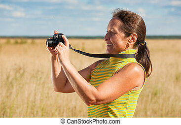 woman taking photo with camera