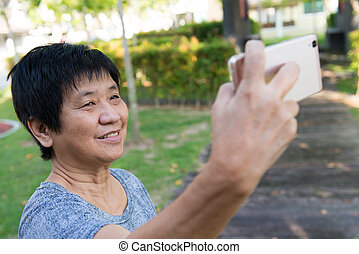 Senior woman taking selfie