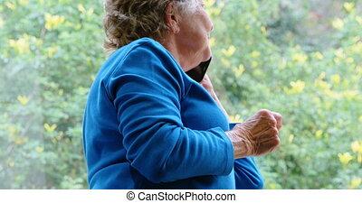 Senior woman talking on mobile phone 4k - Senior woman...