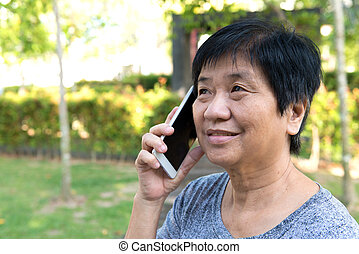 Senior woman talking on smart phone