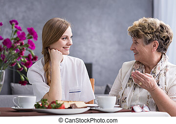 Senior woman talking with carer - Senior woman talking with...