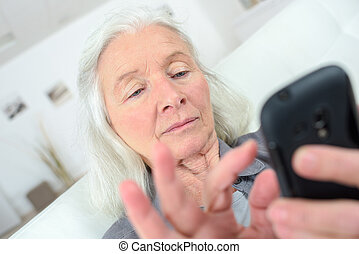 senior woman texting on her new smartphone