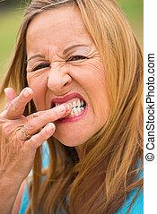 Senior woman toothache outdoor