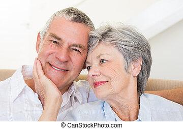 Senior woman touching husband