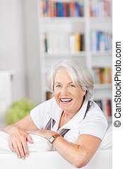 Senior woman unwinding on a sofa