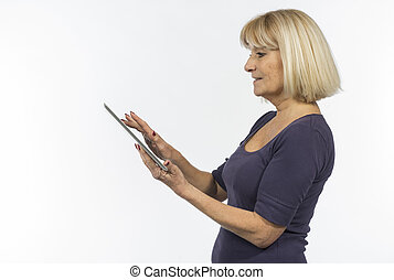 Senior woman using a tablet computer