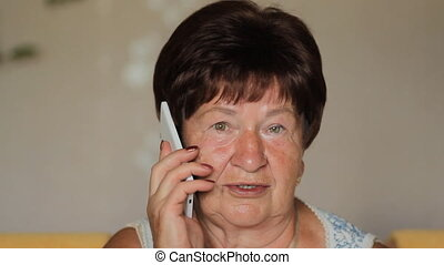 Senior Woman Using Smart Phone At Home. Close up