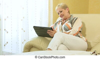 Senior woman viewing photos