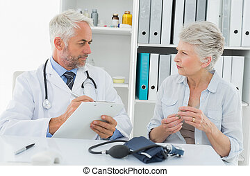 Senior woman visiting doctor