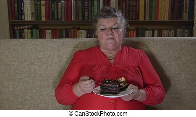 Senior woman watching tv show - Overweight senior woman...