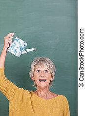 Senior woman watering her hair