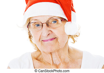 Senior Woman Wearing Santa Hat Over White Background